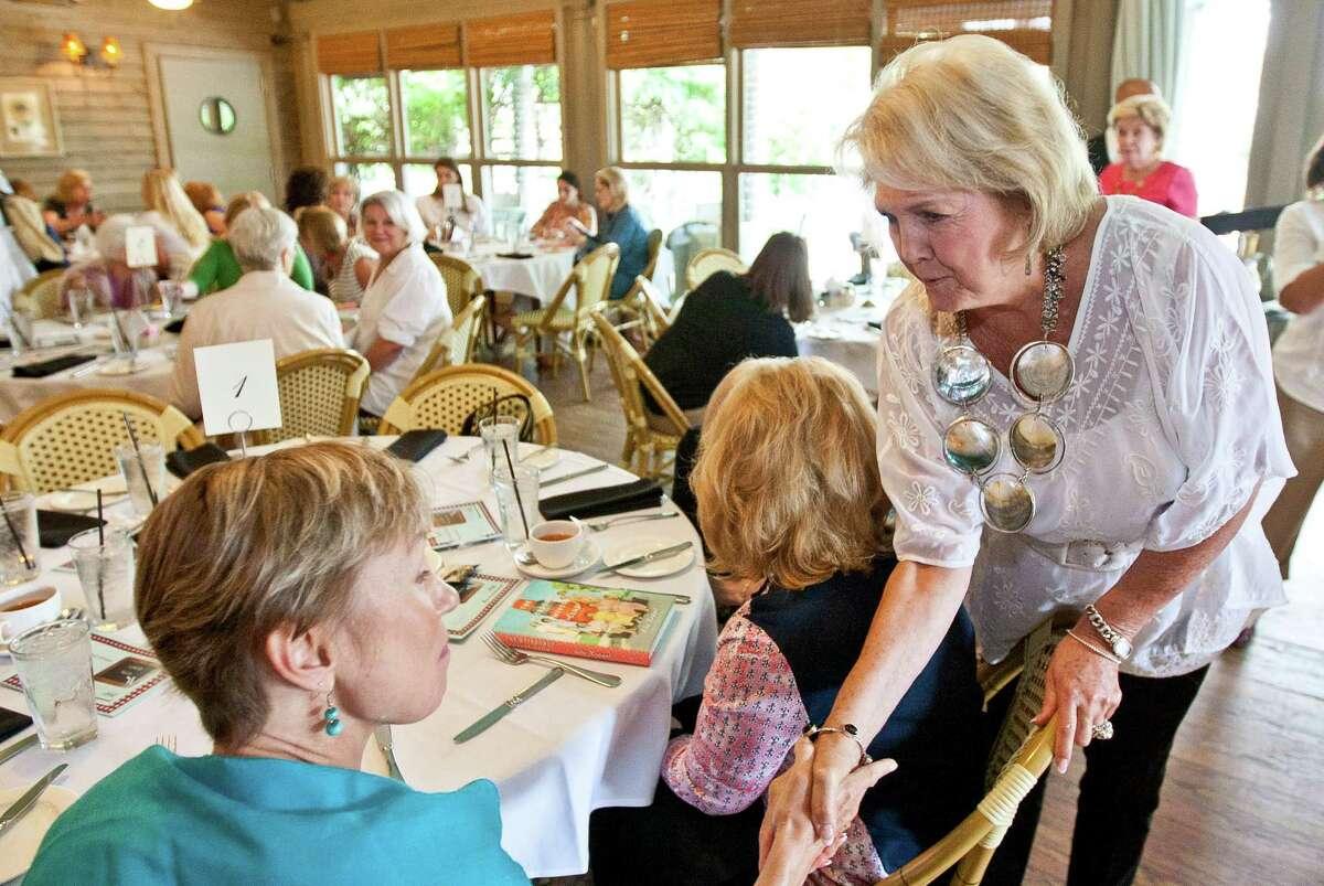 Barbara Cernan Butler introduces herself during a tea and book party.