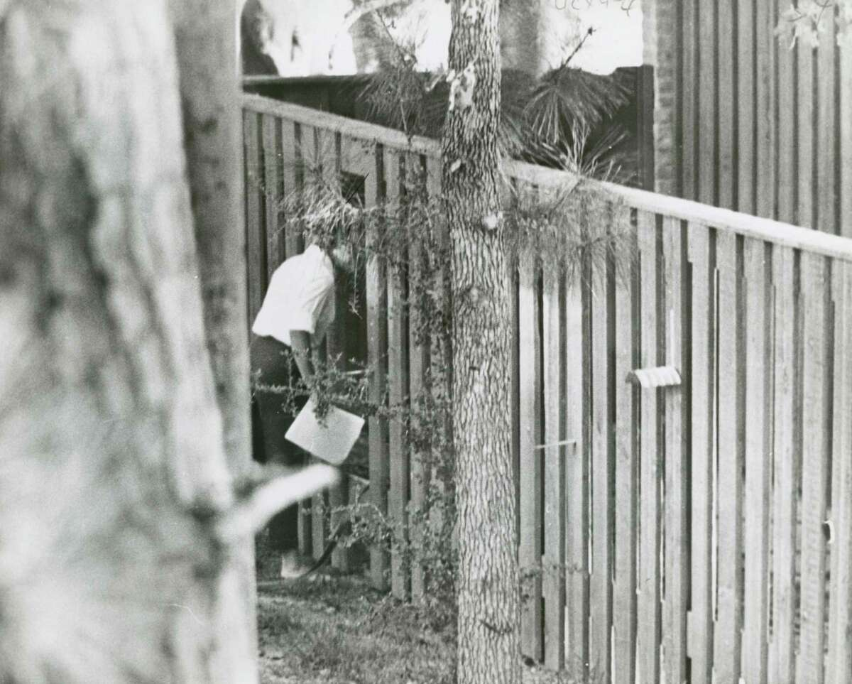 October 3, 1962: Betty Grissom, wife of astronaut Virgil (Gus) Grissom, goes through a passageway cut in the fence to visit her neighbor, Jo Schirra, wife of astronaut Walter Schirra. The two neighbors spent the day watching astronaut Walter Schirra's six-orbit mission lasting 9 hours, 13 minutes, and 11 seconds on board the third Project Mercury mission - capsule Sigma 7. credit: UPI photo HOUCHRON CAPTION (10/03/1962): GOING NEXT DOOR- Mrs. Betty Grissom, wife of astronaut Gus Grissom, went through a passageway cut in the fence to visit with her next-door neighbor. She and her neighbor spent the day watching astronaut Walter Schirra's six-orbit flight. The neighbor is Mrs. Jo Schirra of 207 Pine Shadows Dr., whose husband was America's second man in space.