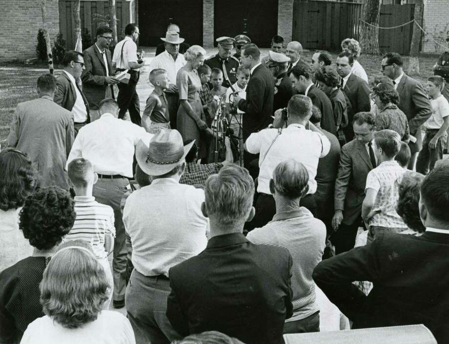 October 3, 1962: Josephine (Jo) Schirra, wife of astronaut Walter Schirra, and her children, Walter Jr. and Suzanne, are surrounded by the news media outside their home in Timber Cove.  Astronaut Schirra had just piloted the third Project Mercury mission. Photo: Jim Doersam, HC Staff / Houston Chronicle