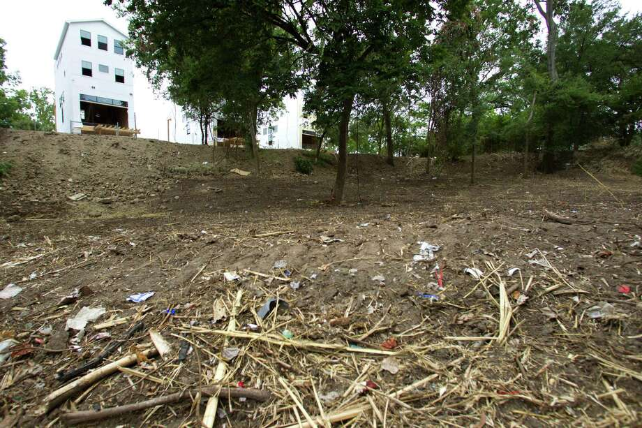 A townhome developer agreed to pay the city $300,000 to restore nearly an acre in Woodland Park north of downtown that was scraped of trees. Photo: Brett Coomer, Staff / © 2013 Houston Chronicle