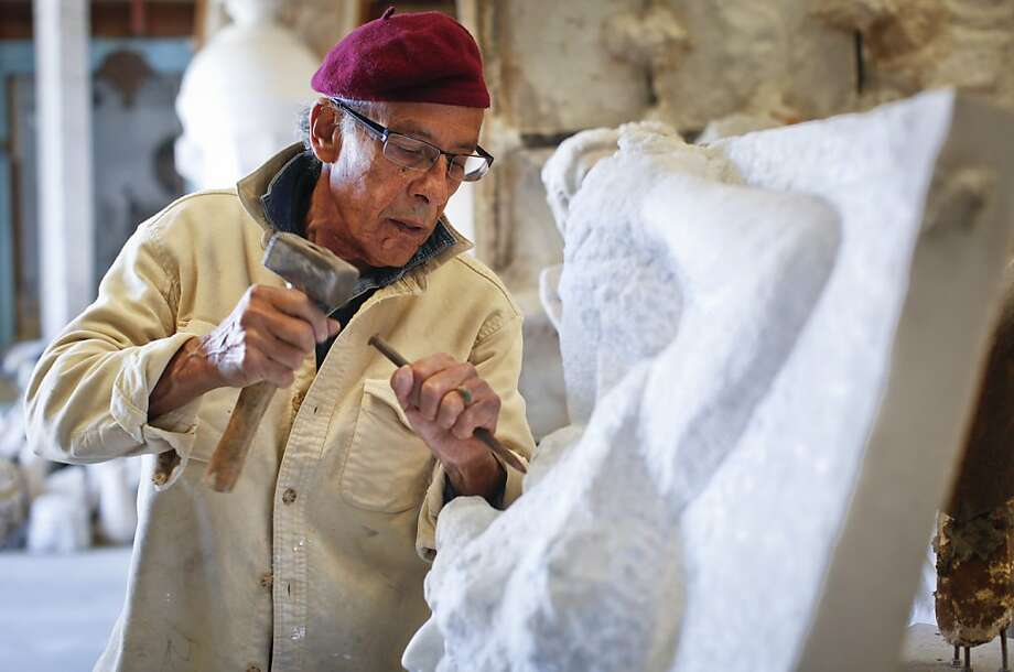 Sculptor Manuel Palos, who once created a dragon fireplace for actor Nicolas Cage, works on a marble piece in his San Francisco workshop. Photo: Russell Yip, The Chronicle