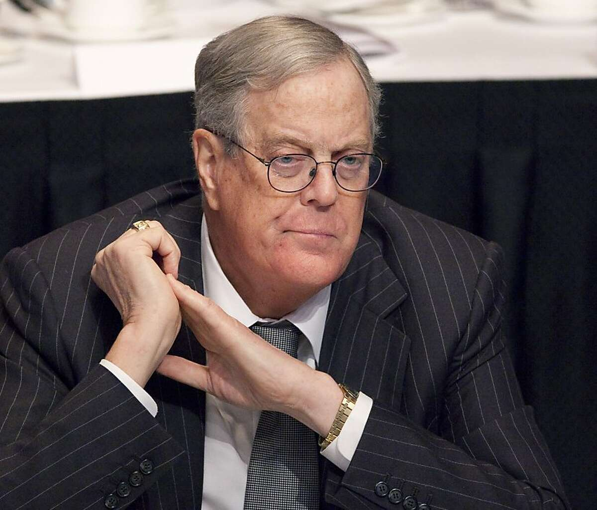 David Koch, executive vice president of Koch Industries, attends a meeting of the Economic Club of New York, Monday, April 11, 2011. (AP Photo/Mark Lennihan)