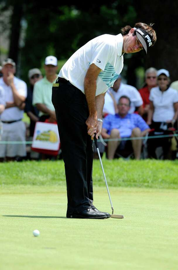 Bubba Watson watches his putt on the seventh green during the second round of the Travelers Championship golf tournament in Cromwell, Conn., Friday, June 21, 2013. Watson shot a 3-under par 67 in his round, to go 10-under par for the tournament. Photo: Fred Beckham