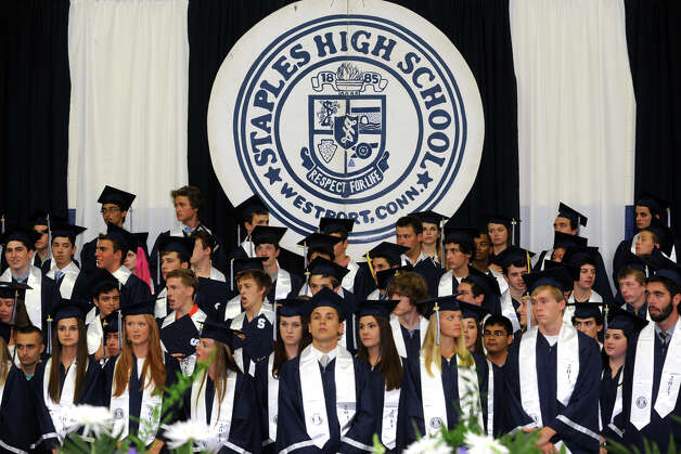 Graduates stand for The Stars Spangled Banner during Commencement Exercises for the Staples High School Class of 2013, in Westport, Conn., June 21st, 2013 Photo: Ned Gerard / Connecticut Post