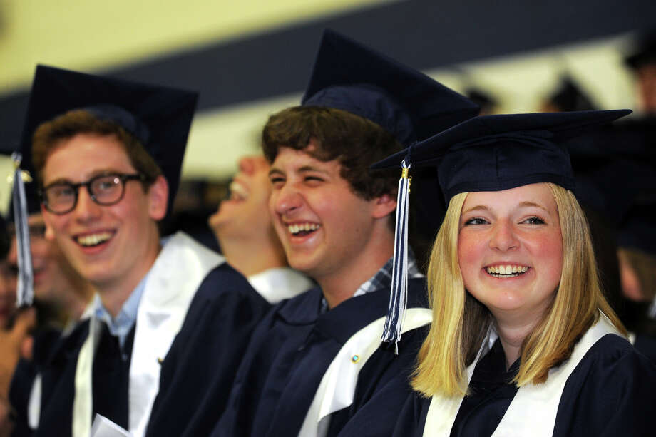 Allie Daut, right, Mathew Kresch, center, and Adam Mirkine, left, share a laugh during Commencement Exercises for the Staples High School Class of 2013, in Westport, Conn., June 21st, 2013 Photo: Ned Gerard / Connecticut Post