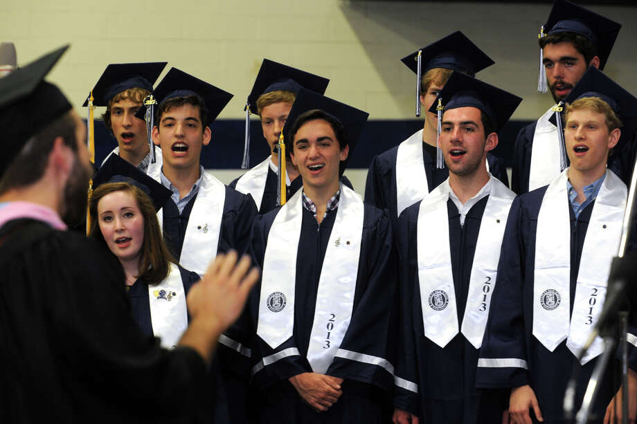 Graduating choir members sing during Commencement Exercises for the Staples High School Class of 2013, in Westport, Conn., June 21st, 2013 Photo: Ned Gerard / Connecticut Post