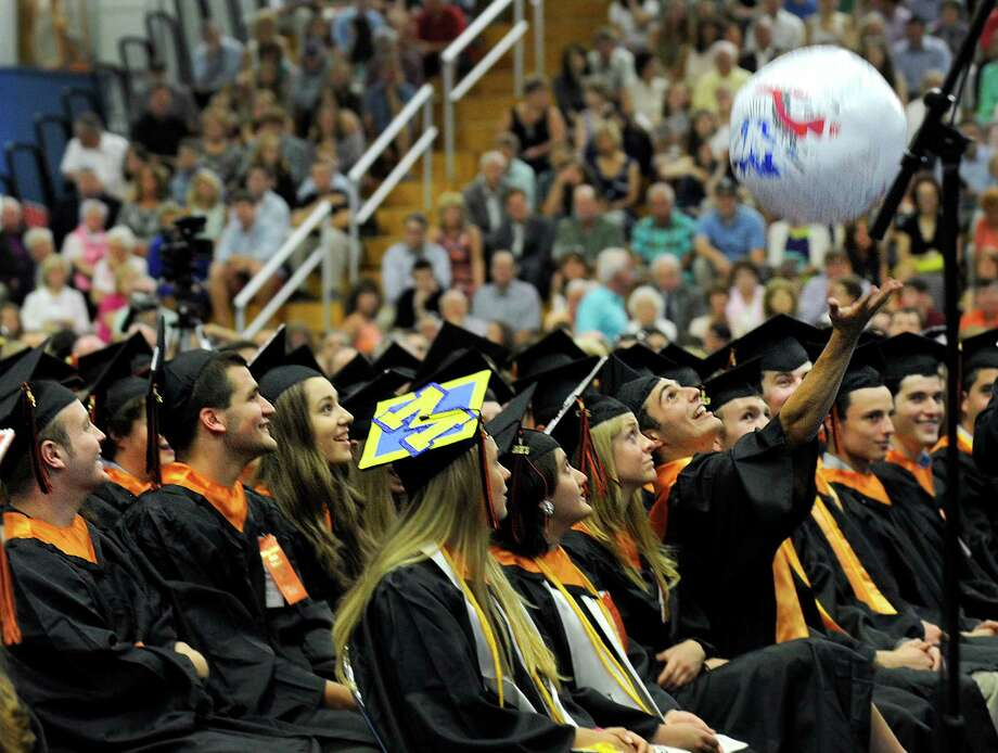 John Pavain reaches for a beachball  being tossed around during graduation Friday afternoon at the Ridgefield High School graduation. The ceremony was held at the O'Neill Center at Western Connecticut State University in Danbury, Conn. Friday, June 21, 2013. Photo: Carol Kaliff / The News-Times