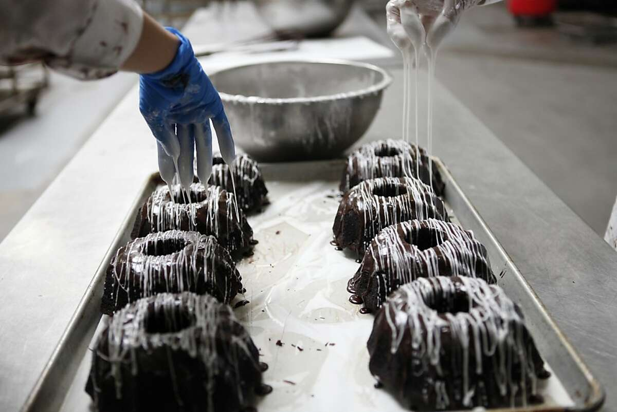 Chocolate cakes are frosted before being packaged at Rubicon Bakery on June 19, 2013 in Richmond, Calif. After years of struggling, Rubicon Bakery, one of the Bay Area's big commercial bakeries, is now breaking $6 million in sales. After Andrew Stoloff came in as CEO, he restructured the business, including hiring a labor force of ex cons.