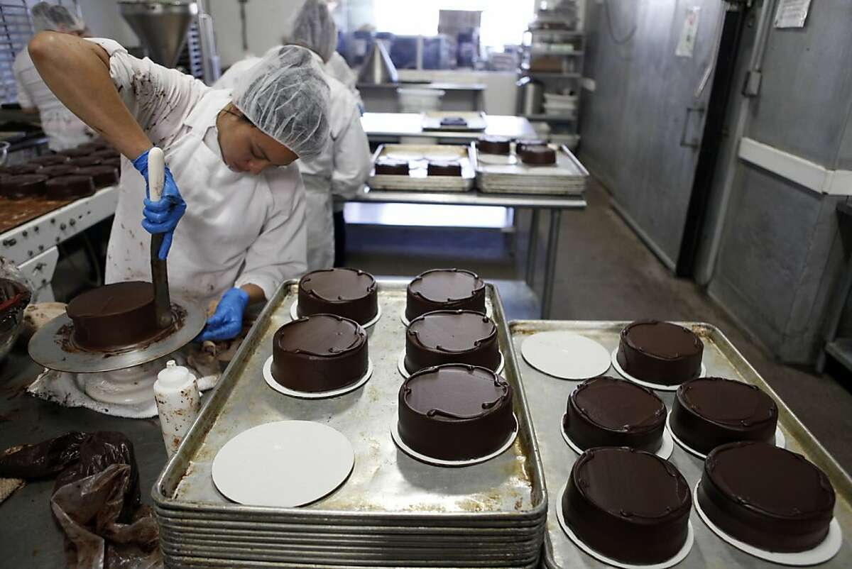 Dinora Aluarado frosts cakes at Rubicon Bakery, one of the Bay Area's big commercial bakeries, in Richmond, Calif on June 19, 2013.