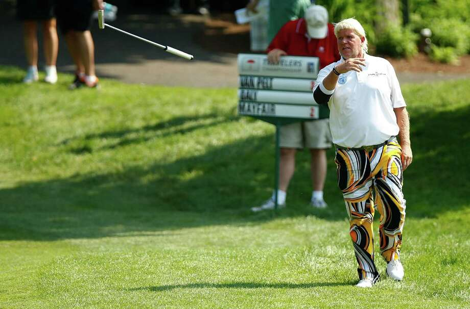 CROMWELL, CT- JUNE 21:  John Daly throws his club in the direction of his caddy after missing a putt on the 15th green during the second round of the 2013 Travelers Championship at TPC River Highlands on June 21, 2012 in Cromwell, Connecticut. Photo: Jared Wickerham, Getty Images / 2013 Getty Images