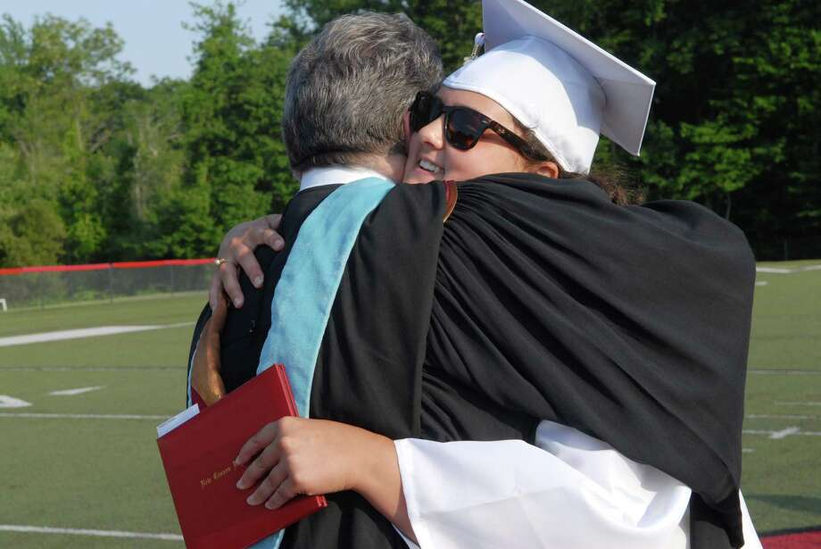 Assistant principal Ari Rothman gives Amanda Frattaroli a hug after she receives her diploma at New Canaan ( Conn. ) High School graduation commencement ceremony on Friday June 21, 2013. Photo: Dru Nadler / Stamford Advocate Freelance