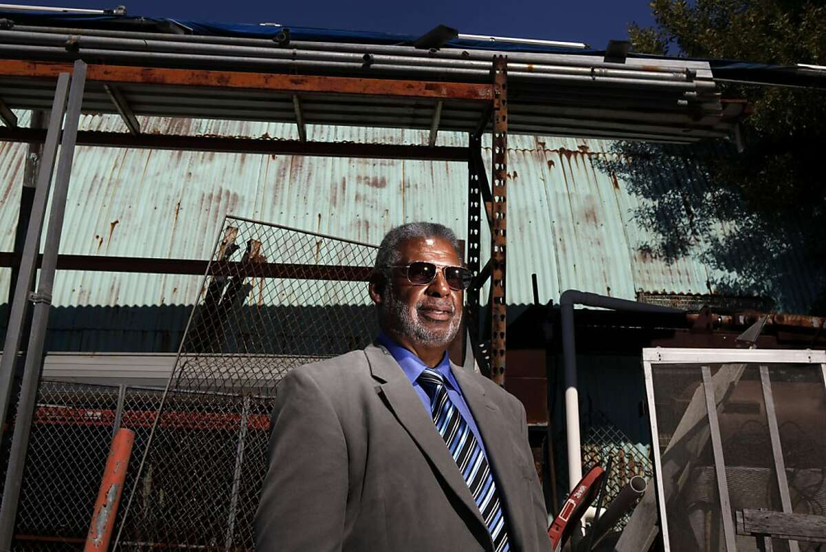 Corky Boozé shows his commercial property on Wednesday, June 19, 2013, in Richmond, Calif. Boozé must go to jail and pay a fine if he allows junk to accumulate on property he has maintained for decades, a judge has ruled.
