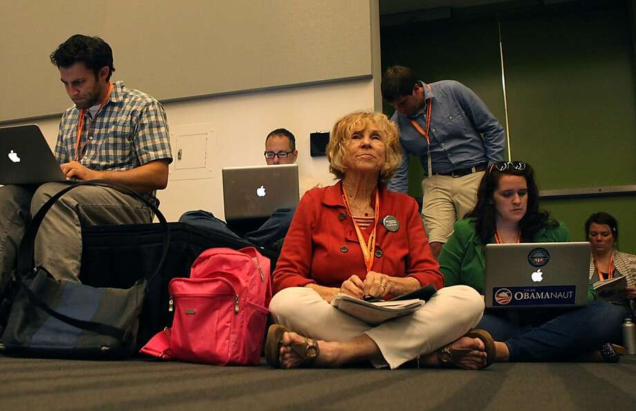 Elijah Zarlin (left), Peggy Reskin and Brandi Edwards, all of Oakland, attend a session at the Netroots Nation conference. Photo: Liz Hafalia, The Chronicle