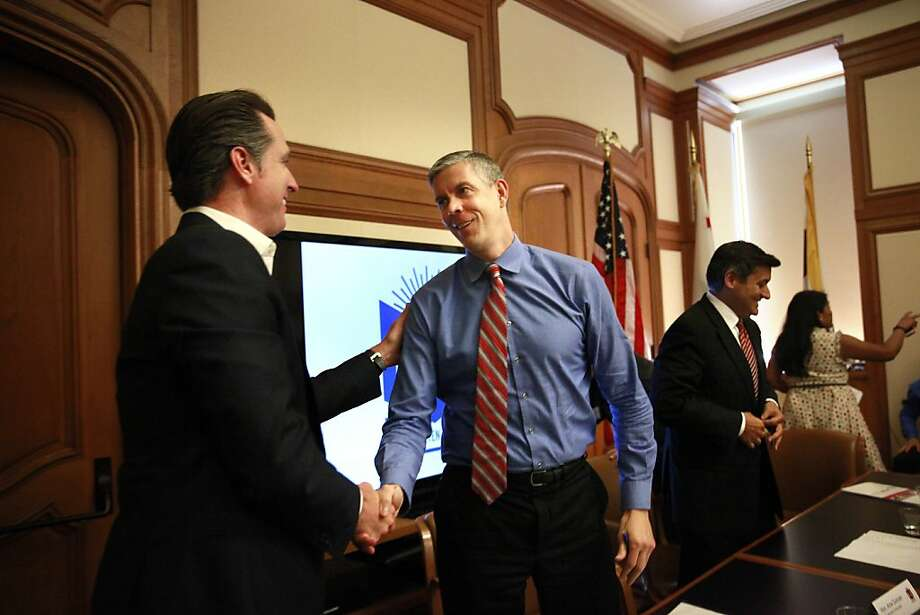 Lt. Gov. Gavin Newsom (left), who as S.F. mayor instituted the Kindergarten to College program, greets U.S. Secretary of Education Arne Duncan after a roundtable discussion. Photo: Lea Suzuki, The Chronicle