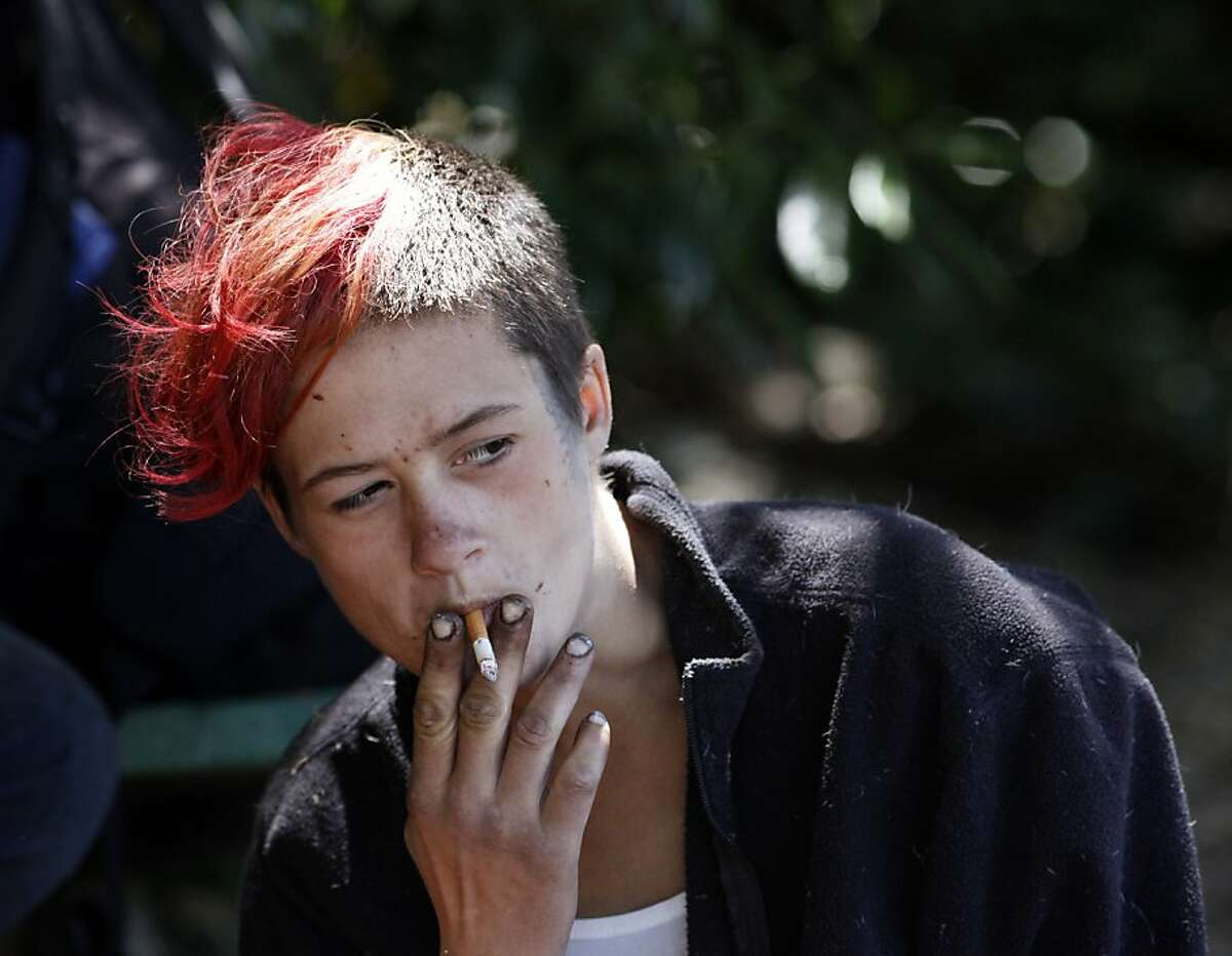 Amber Blinzler, 21, has been homeless for 10 years, hangs out in Buena Vista Park, Friday June 21, 2013, in San Francisco, Calif. The biennial San Francisco homeless count, which is to be released Friday.