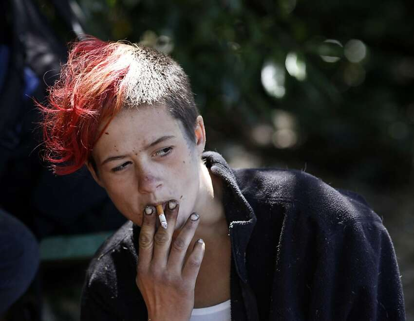 Amber Blinzler, 21, who has been homeless for 10 years, hangs out in Buena Vista Park.