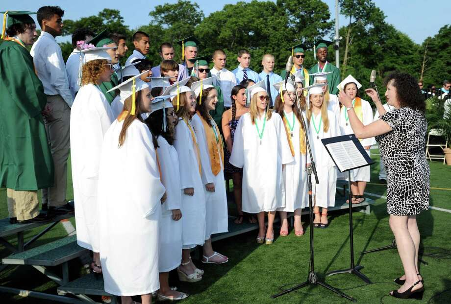The Norwalk High School Choir Ensemble is directed by Susan Pettibone as they perform during Friday's commencement ceremony at Norwalk High School on June 21, 2013. Photo: Lindsay Perry / Stamford Advocate