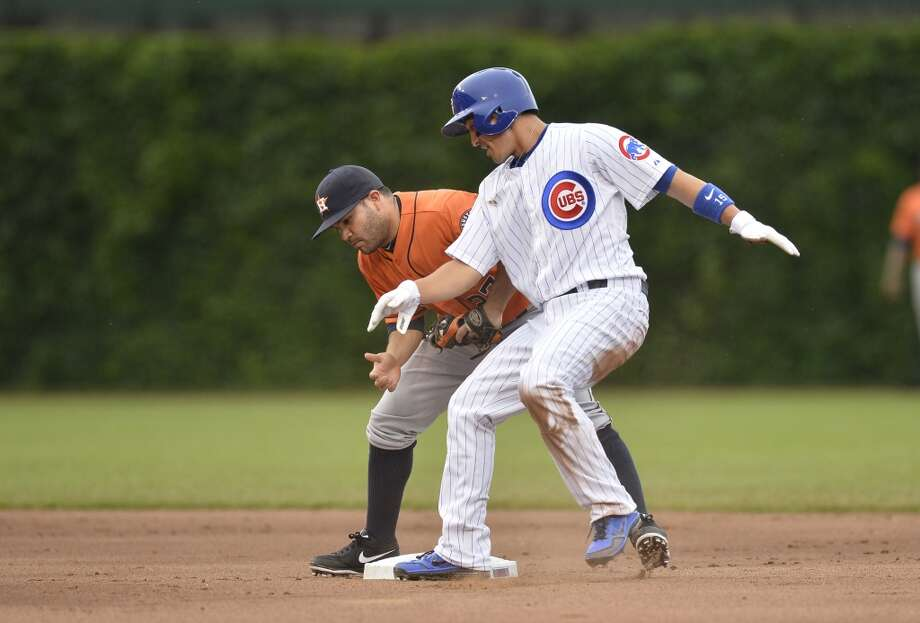 Jose Altuve tags out Darwin Barney on a steal attempt during the first inning.