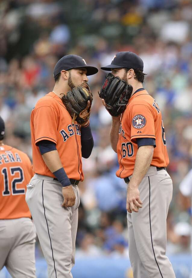 Marwin Gonzalez talks with Dallas Keuchel during the third inning.