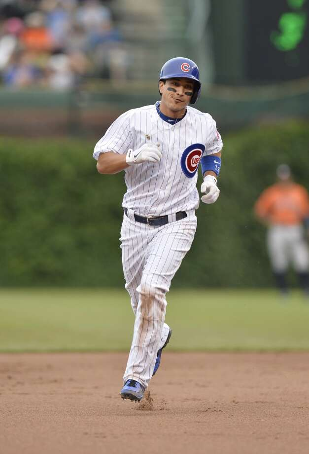 Darwin Barney rounds the bases after hitting a solo home run during the fifth inning.