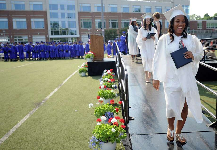 Graduates cross the stage to get their diplomas during Friday's commencement ceremony at Brien McMahon High School on June 21, 2013. Photo: Lindsay Perry / Stamford Advocate