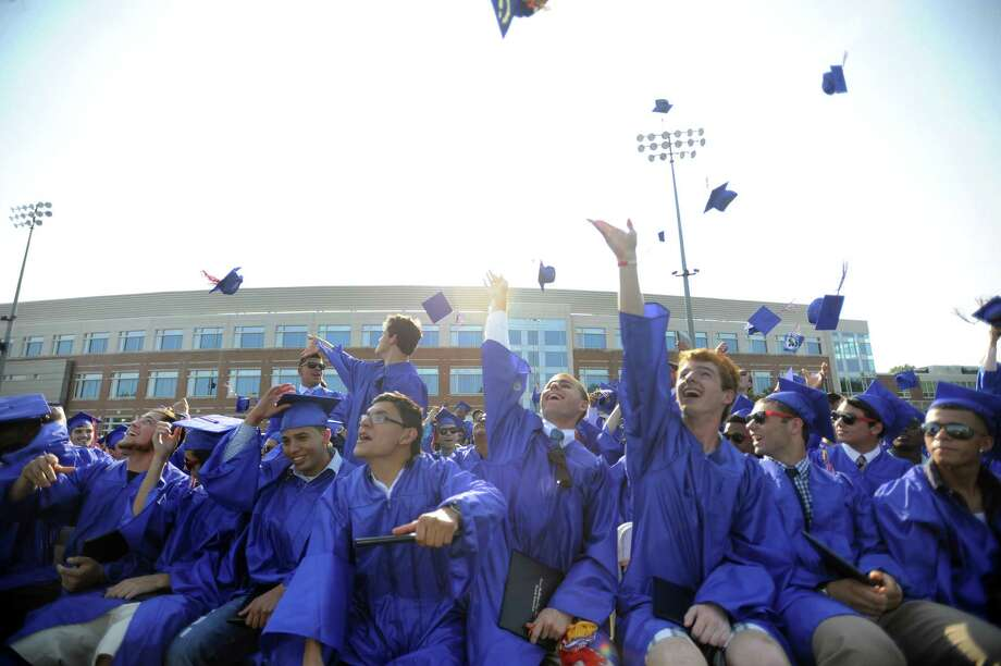 Graduates throw their caps during Friday's commencement ceremony at Brien McMahon High School on June 21, 2013. Photo: Lindsay Perry / Stamford Advocate