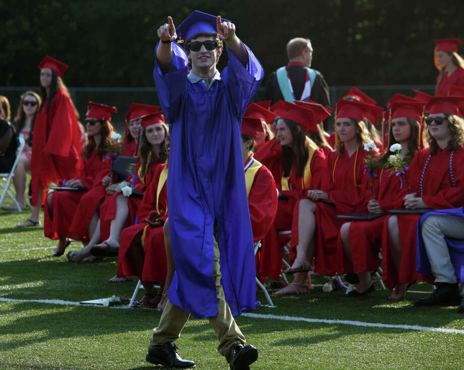 Joseph A. Foran high school graduate Christopher McGann reacts to audience cheers during commencement exercises in Milford, Conn., on Friday, June 21, 2013 Photo: BK Angeletti, B.K. Angeletti / Connecticut Post freelance B.K. Angeletti