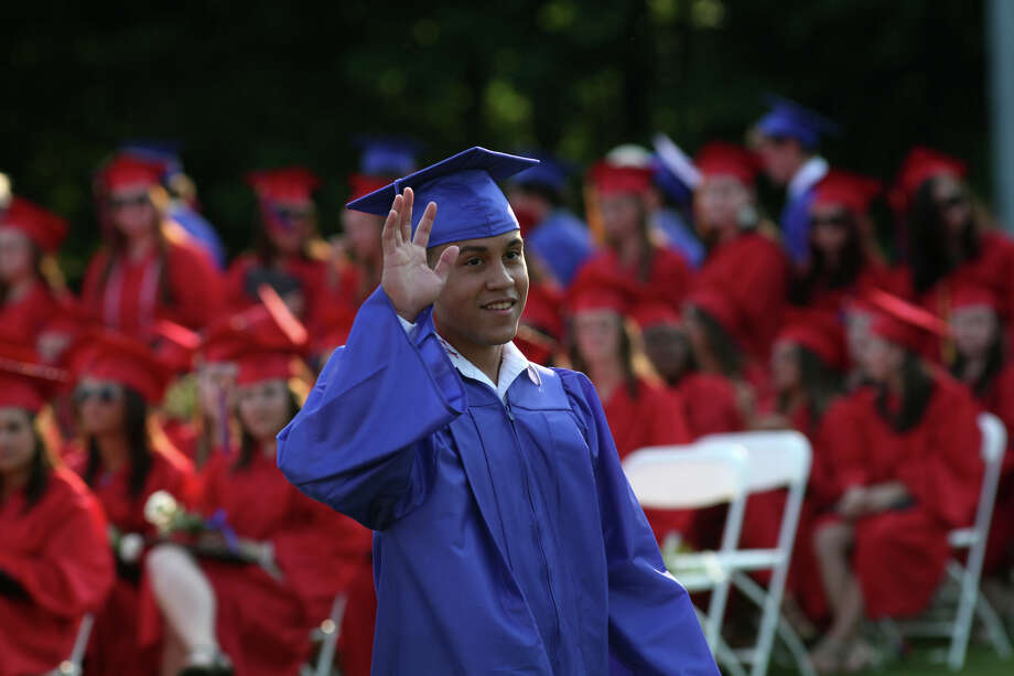 Joseph A. Foran high school graduate Jesus Ortiz waves during commencement exercises in Milford, Conn., on Friday, June 21, 2013 Photo: BK Angeletti, B.K. Angeletti / Connecticut Post freelance B.K. Angeletti