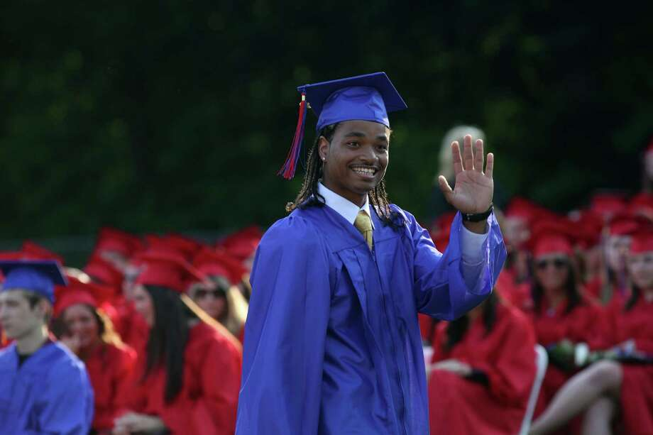 Joseph A. Foran high school graduate Demetrius Troupe waves during commencement exercises in Milford, Conn., on Friday, June 21, 2013 Photo: BK Angeletti, B.K. Angeletti / Connecticut Post freelance B.K. Angeletti