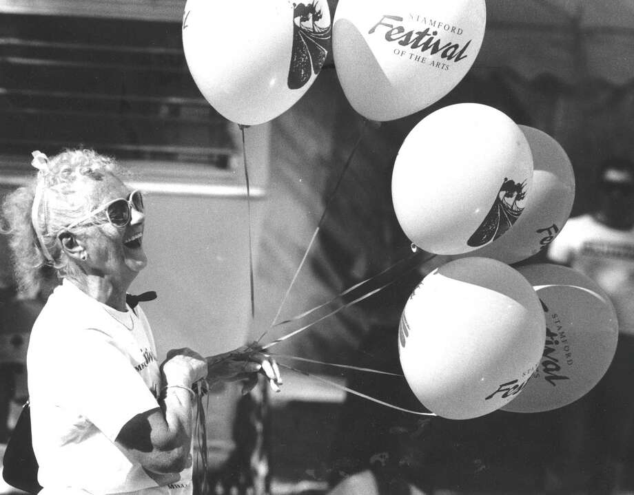 Stamford Festival of the Arts volunteer Karen McCaan holds on tight to balloons at the festival on June 26, 1988. Photo: Advocate
