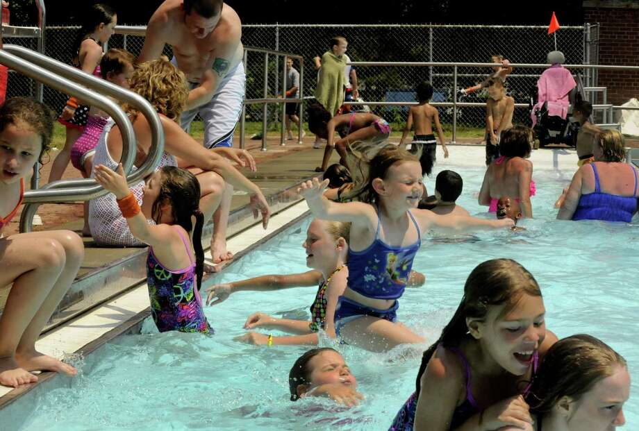Children and adults enjoy the relief  from the heat at the Watervliet Veterans Memorial Pool Friday June 29, 2012, in Watervliet, N.Y. (Michael P. Farrell/Times Union) Photo: Michael P. Farrell / 00018295A