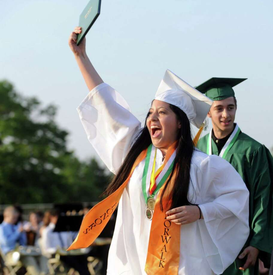 Ana Galarza celebrates after getting her diploma during Friday's commencement ceremony at Norwalk High School on June 21, 2013. Photo: Lindsay Perry / Stamford Advocate