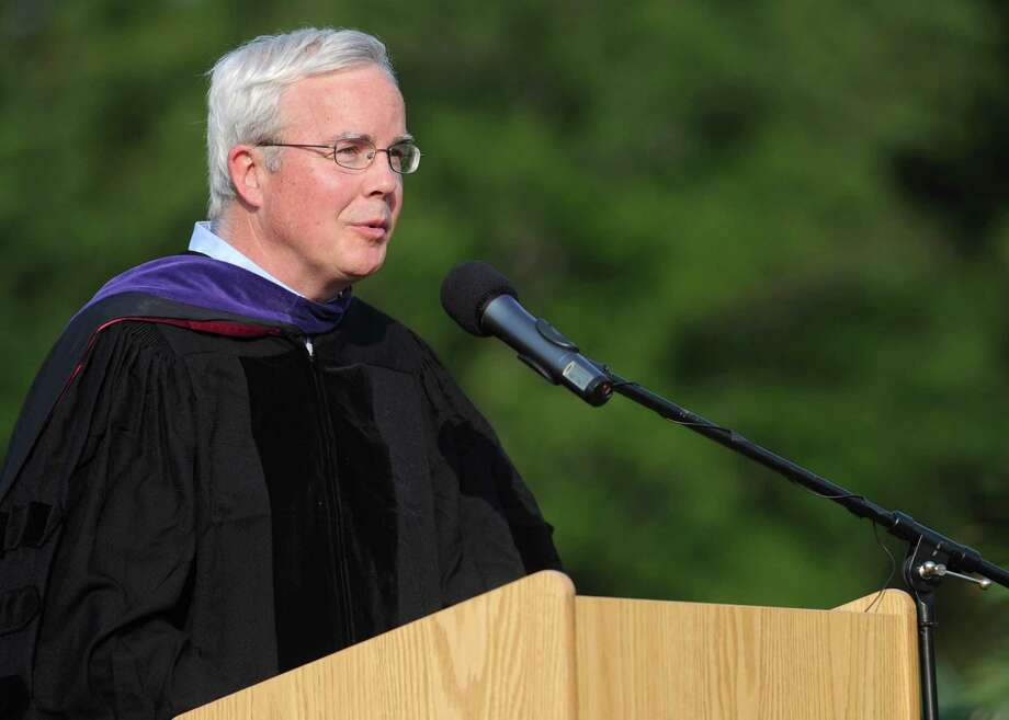 Michael Lyons of the Board of Education speaks during Friday's commencement ceremony at Norwalk High School on June 21, 2013. Photo: Lindsay Perry / Stamford Advocate