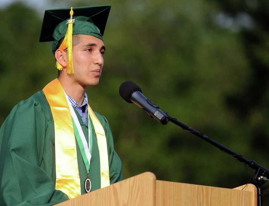Class President Edwin Rosales speaks during Friday's commencement ceremony at Norwalk High School on June 21, 2013. Photo: Lindsay Perry / Stamford Advocate