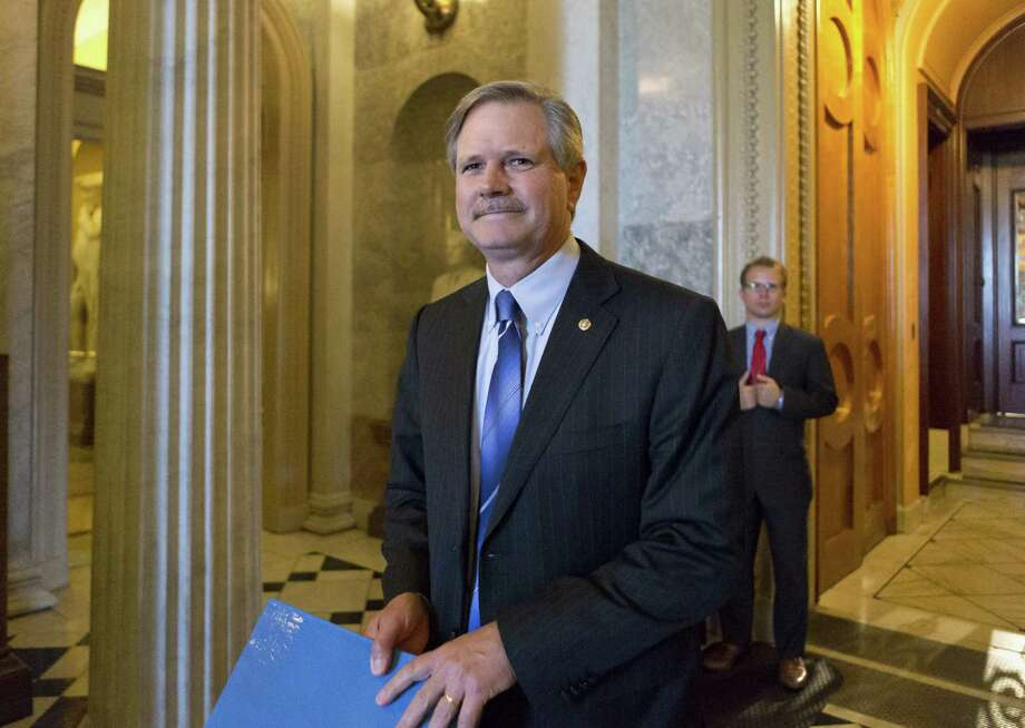 Sen. John Hoeven, N.D., leaves the Senate chamber on Capitol Hill in Washington, Friday, June 21, 2013, after speaking on his amendment to the immigration reform bill. Hoeven and Sen. Bob Corker, R-Tenn., are pushing an amendment that insists on increased border security with an increase in Border Patrol agents and unmanned surveillance drones. (AP Photo/J. Scott Applewhite) Photo: J. Scott Applewhite