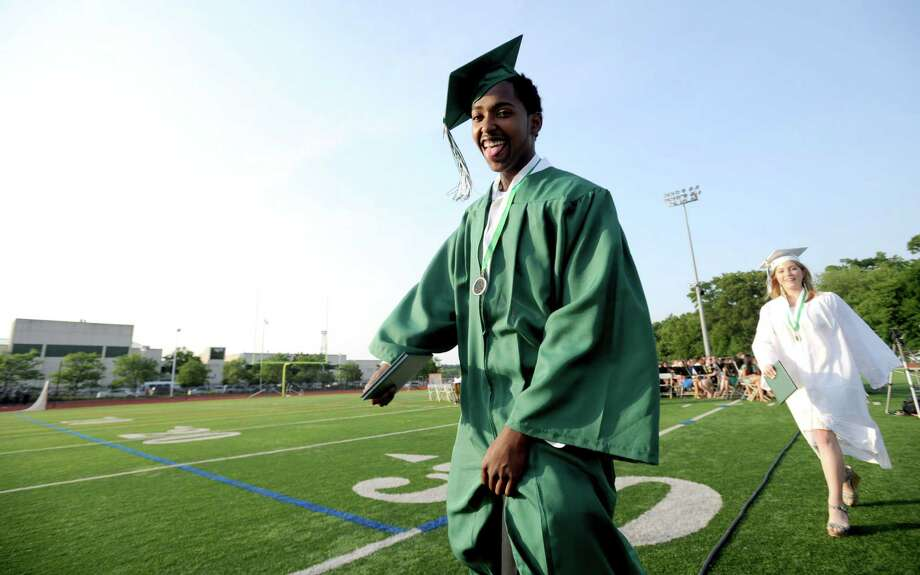 Manuel Diaz celebrates after getting his diploma during Friday's commencement ceremony at Norwalk High School on June 21, 2013. Photo: Lindsay Perry / Stamford Advocate