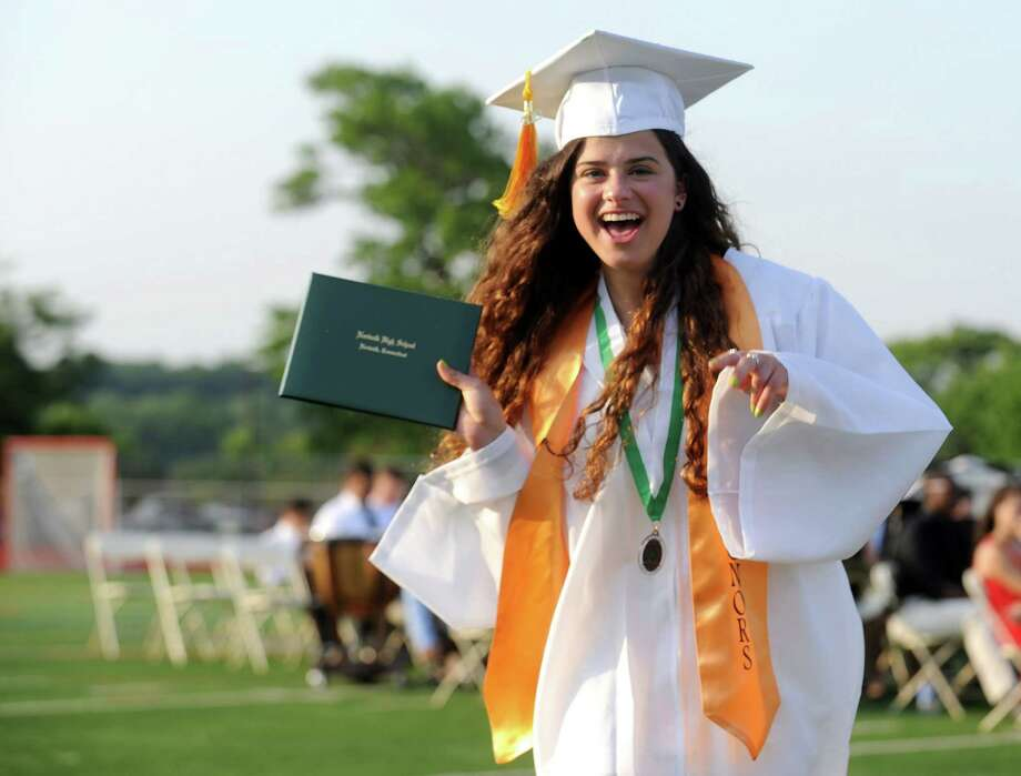 Halle Gavrielidis celebrates after getting her diploma during Friday's commencement ceremony at Norwalk High School on June 21, 2013. Photo: Lindsay Perry / Stamford Advocate