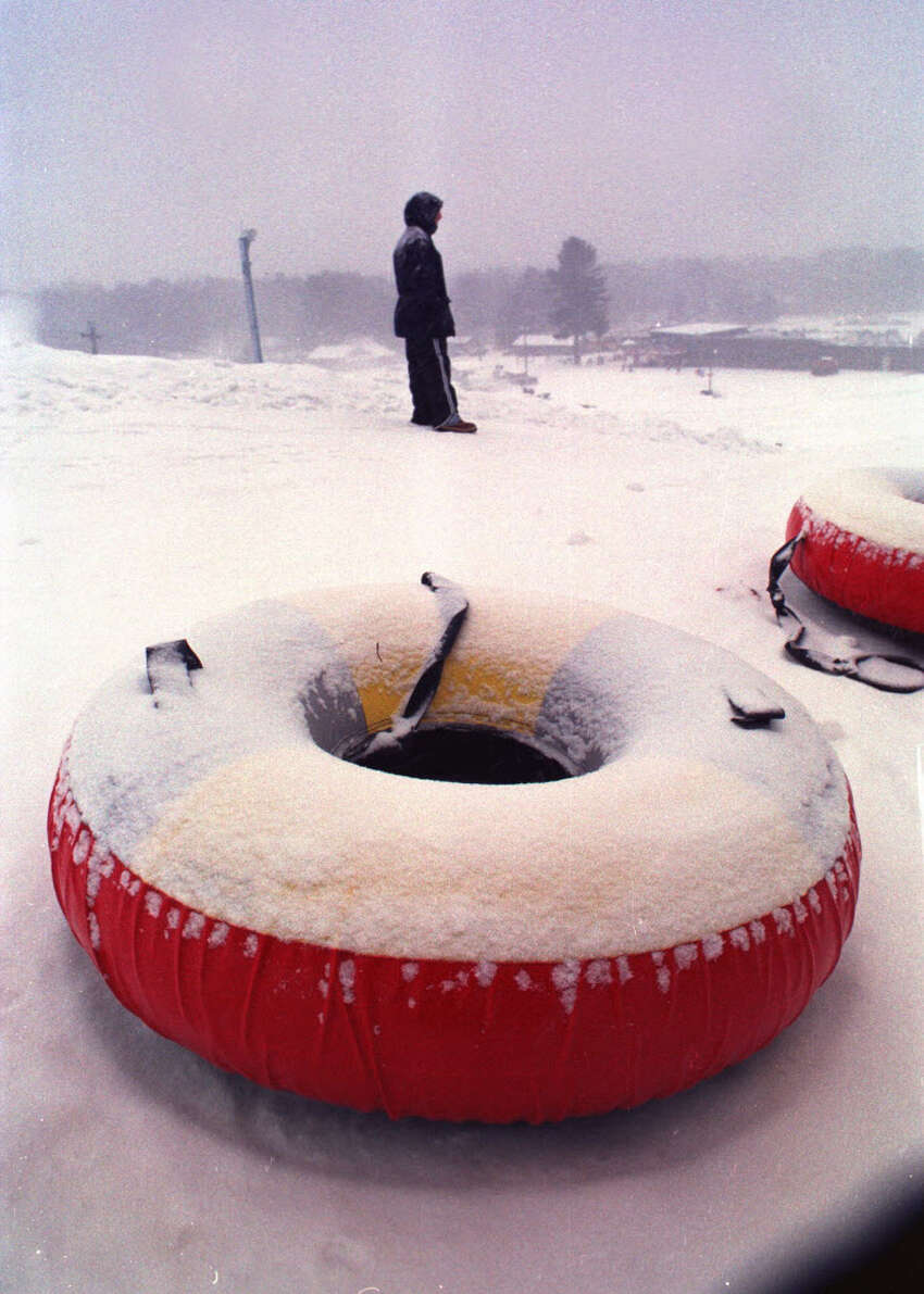 Times Union Staff Photo by PAUL BUCKOWSKI -- WEDNESDAY JANUARY 6 1999 -- WEST MOUNTAIN -- Tubes sit at the top of one of the runs at the Tubing Park at West Mountain.