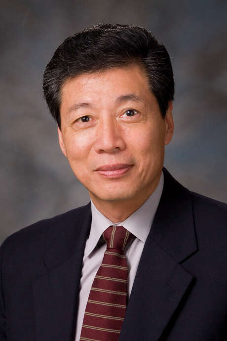 Dr. Kian Ang, a renown cancer physician at MD Anderson, has died. Beloved by his colleagues, Ang has been an influential figure in MD Anderson tradition of ringing the bell at the finish of radiation treatments.   Photo credit: Courtesy of MD Anderson. Photo: Courtesy Of MD Anderson. / Visual Art 2011 The University of Texas M.D. Anderson Cancer Center