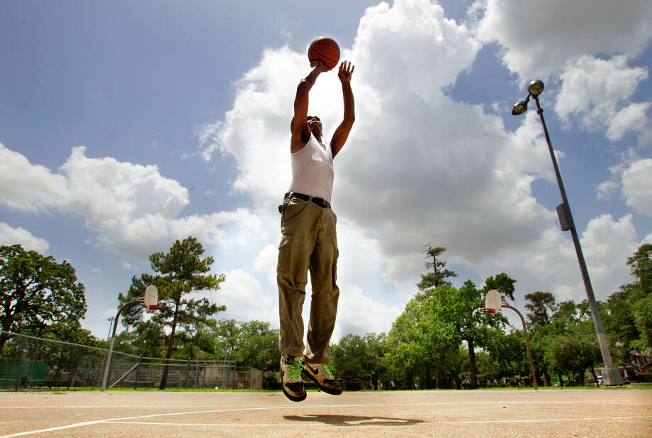 "Charles Brown shoots hoops at Woodland Park, Friday, June 21, 2013, in Houston. ""It sure feels like the first day of summer,"" he said. Photo: Cody Duty, Houston Chronicle / © 2013 Houston Chronicle"