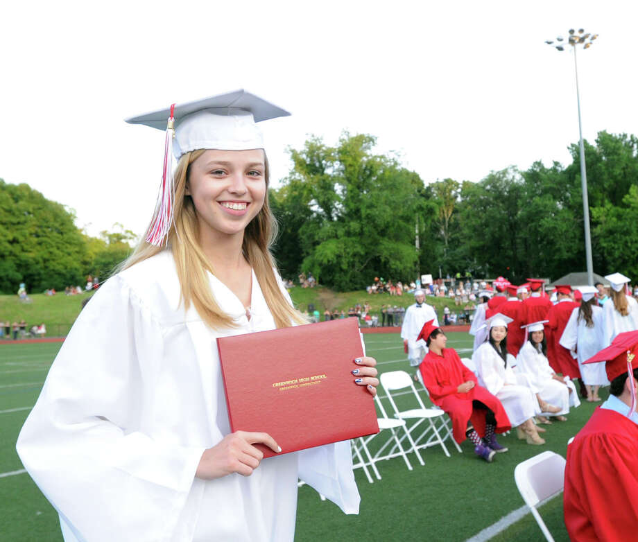 Connie Bowman displays her diploma during the Greenwich High School graduation ceremony at Cardinal Stadium, Friday evening, June 21, 2013. Photo: Bob Luckey / Greenwich Time