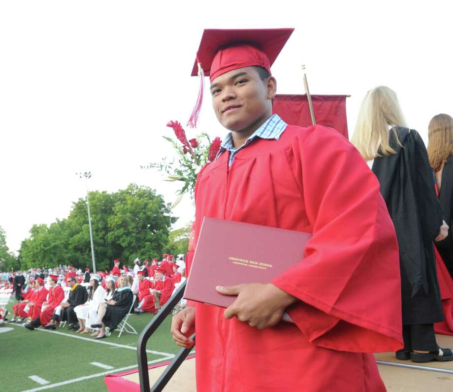 Cam Fennell after receiving his diploma during the Greenwich High School graduation ceremony at Cardinal Stadium, Friday evening, June 21, 2013. Photo: Bob Luckey / Greenwich Time