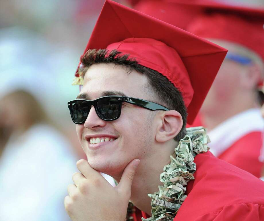 Graduating senior, Leonard Bici, 17, smiles during the Greenwich High School graduation ceremony at Cardinal Stadium, Friday evening, June 21, 2013. Bici said he will be attending St. Lawrence University in the fall. Photo: Bob Luckey / Greenwich Time