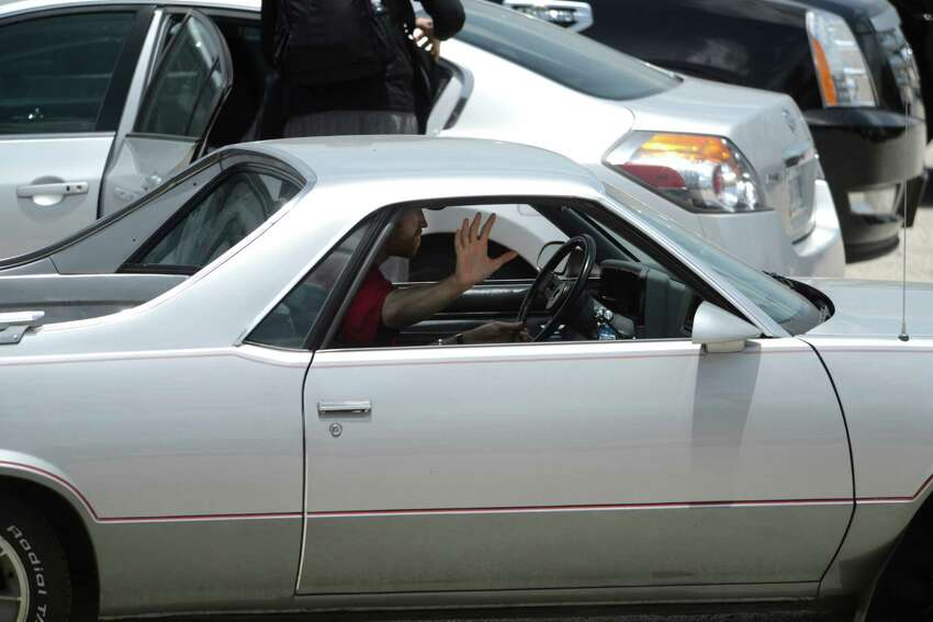 Matt Bonner of the San Antonio Spurs drives off from the San Antonio airport in his vintage El Camino after the team's return to San Antonio from Miami on Friday, June 21, 2013.