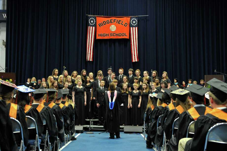 "The Graduation Choir sings ""There You'll Be"" at Ridgefield High School's graduation ceremony Friday, June 21, 2013, at the O'Neill Center at Western Connecticut State University in Danbury, Conn. Photo: Carol Kaliff / The News-Times"