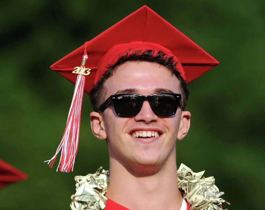 Graduating senior Leonard Bici, 17, smiles during the Greenwich High School graduation ceremony at Cardinal Stadium, Friday evening, June 21, 2013. Photo: Bob Luckey / Greenwich Time