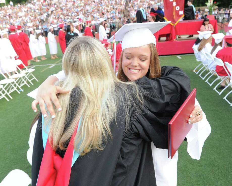 At right, Meredith Clark, 17, after receiving her diploma during the Greenwich High School graduation ceremony at Cardinal Stadium, Friday evening, June 21, 2013. Photo: Bob Luckey / Greenwich Time