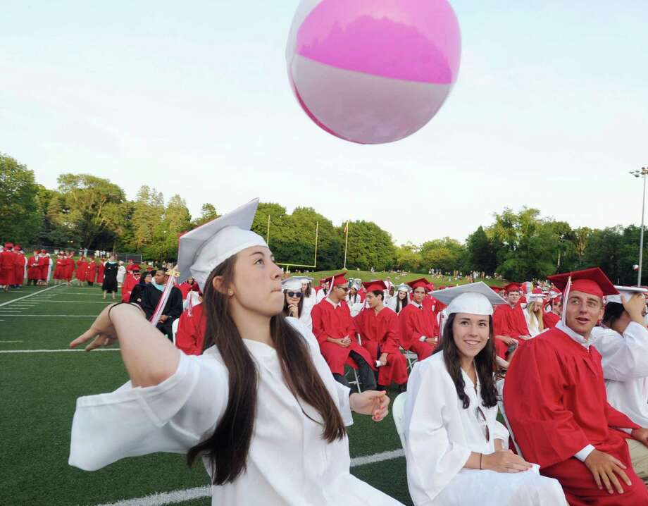 Graduating senior Rebecca Kural hits a beach ball during the Greenwich High School graduation ceremony at Cardinal Stadium, Friday evening, June 21, 2013. Photo: Bob Luckey / Greenwich Time