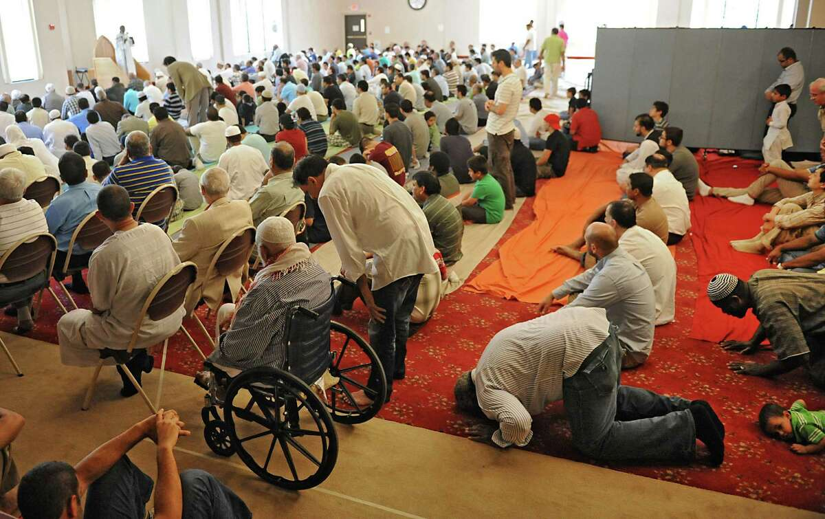 People attend the weekly Friday prayer service at the Islamic Center of Capital Region on Friday, June 21, 2013 in Schenectady, N.Y. (Lori Van Buren / Times Union)