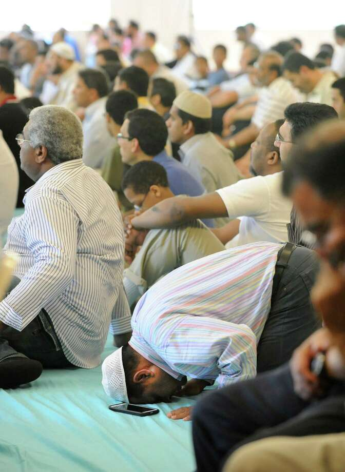 People attend the weekly Friday prayer service at the Islamic Center of Capital Region on Friday, June 21, 2013 in Schenectady, N.Y. (Lori Van Buren / Times Union) Photo: Lori Van Buren / 00022916A